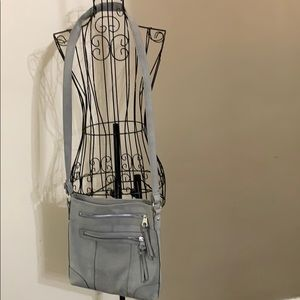 Grey leather like cross body bag, from Maurice's